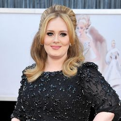 """FILE - In this Feb. 24, 2013 file photo, singer Adele arrives at the Oscars in Los Angeles. Adele releases her new album, """"25,"""" on Friday, Nov. 20. (Photo by John Shearer/Invision/AP, File)"""