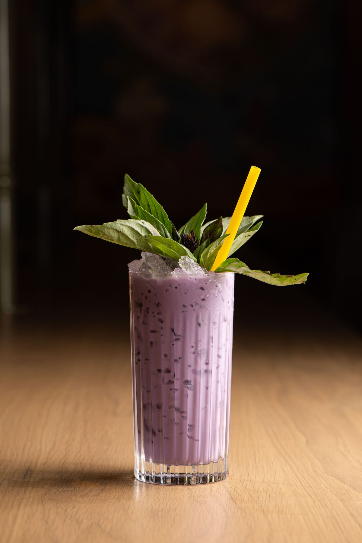 A tall purple cocktail made with ube.
