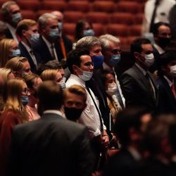 Masked attendees watch the Saturday evening session of the 191st Semiannual General Conference of The Church of Jesus Christ of Latter-day Saints at the Conference Center in Salt Lake City on Saturday, Oct. 2, 2021.