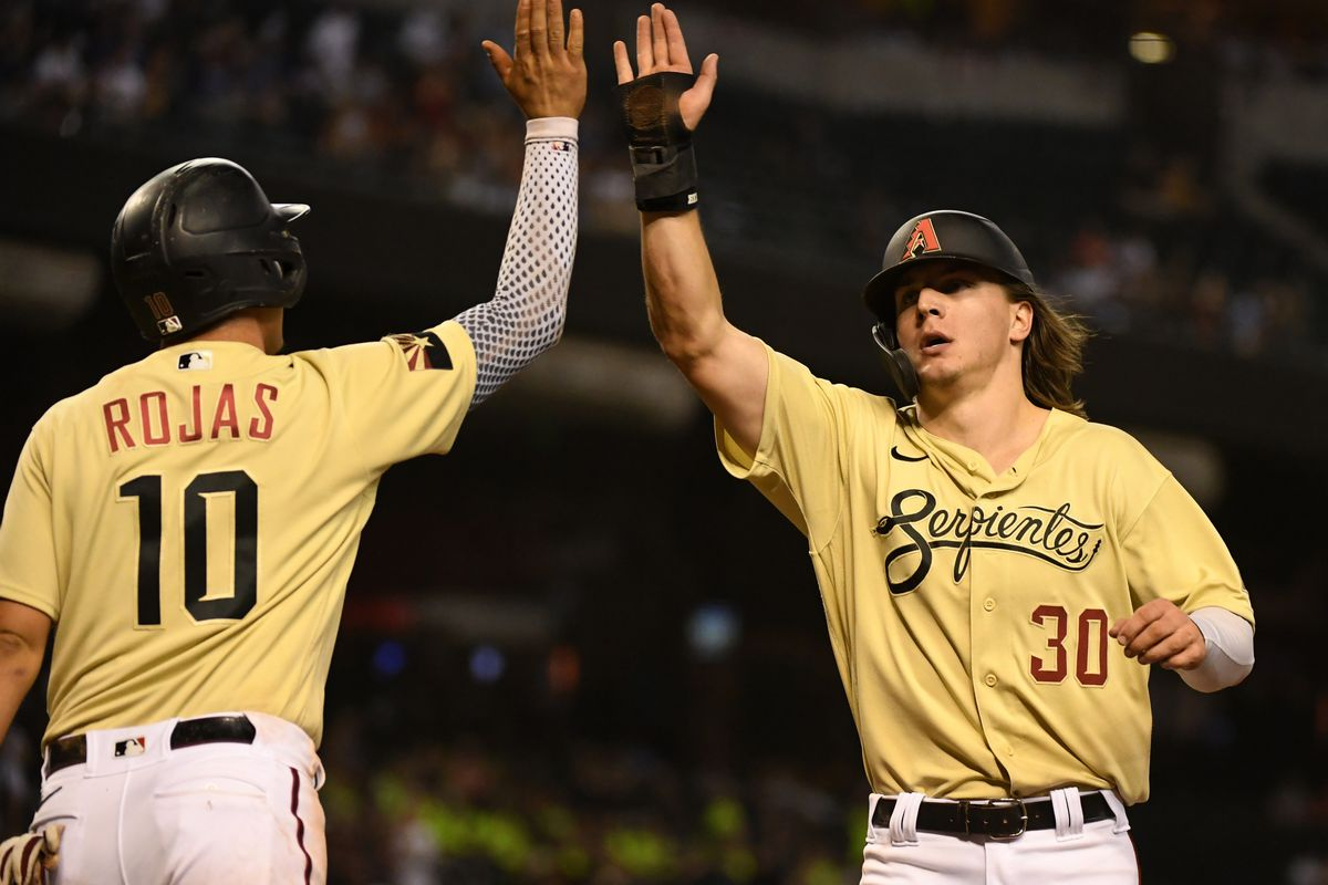 Jake McCarthy and Josh Rojas celebrate.