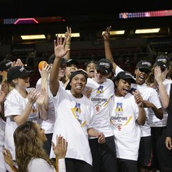 Southern California's Ariya Crook, center, waves after being named tournament MVP after after the team beat Oregon State to win the Pac-12 NCAA college championship basketball game Sunday, March 9, 2014, in Seattle. USC won 71-62. (AP Photo/Elaine Thompson)