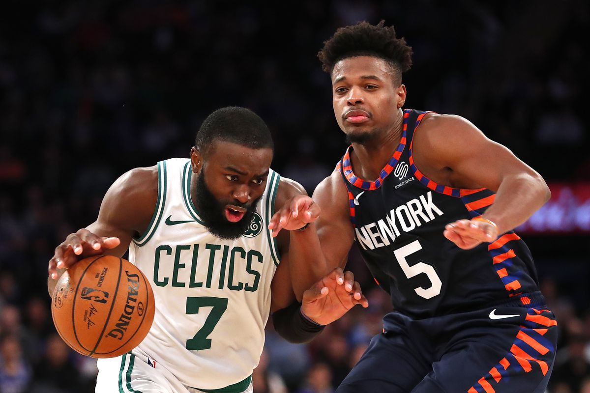 Boston Celtics guard Jaylen Brown drives to the basket against New York Knicks guard Dennis Smith Jr. during the second half at Madison Square Garden.