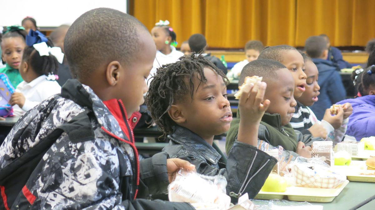 Kids eating lunch at Aspire Hanley Elementary, in Orange Mound.