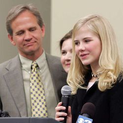Elizabeth Smart and her parents Ed and Lois speak briefly during a press conference at the Partners in Safety fair in Rose Park Mar 12, 2005.