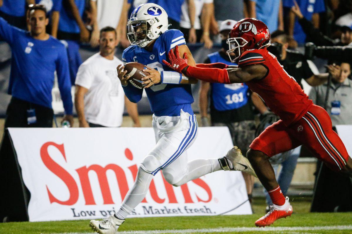 Brigham Young Cougars quarterback Jaren Hall gets pushed by Utah Utes cornerback Clark Phillips III.