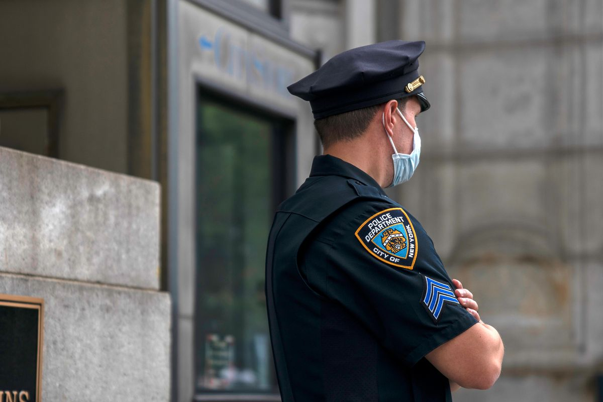 An NYPD officer stands guard in lower Manhattan, Aug. 28, 2020.