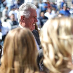 Dieter F. Uchtdorf, second counselor to the First Presidency of the Church of Jesus Christ of Latter-day Saints, talks to cheerleaders before the game between the Brigham Young Cougars and the Wisconsin Badgers at LaVell Edwards Stadium in Provo on Saturday, Sept. 16, 2017.
