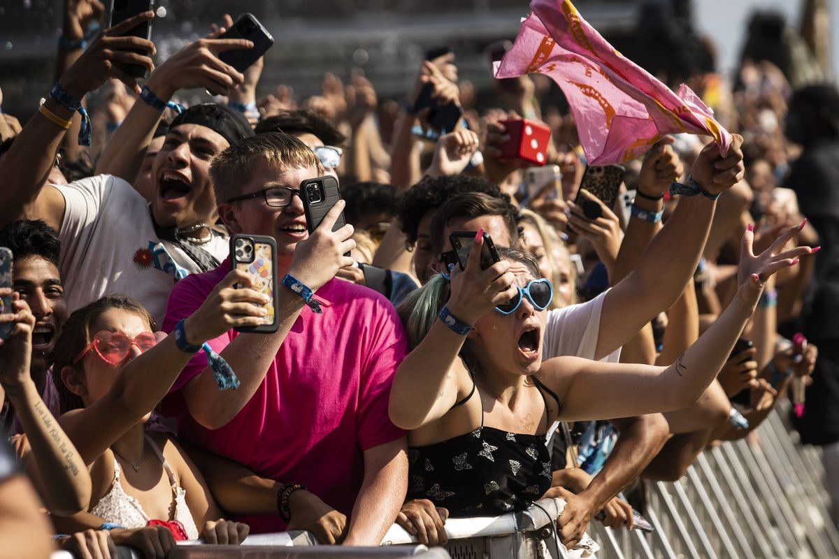 Fans cheer as Trippie Redd performs Saturday afternoon at Lollapalooza.
