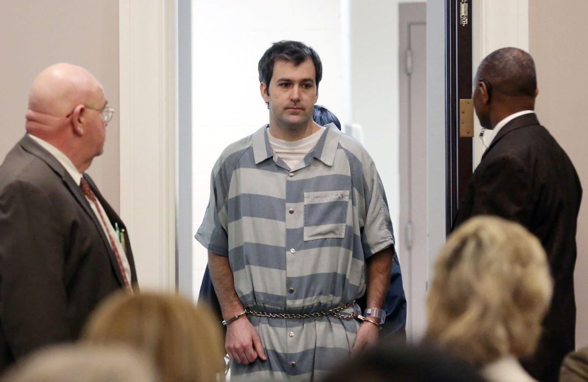 Former North Charleston police officer Michael Slager is led into court on Sept. 10, 2015, in Charleston, South Carolina.   Grace Beahm/The Post And Courier via AP