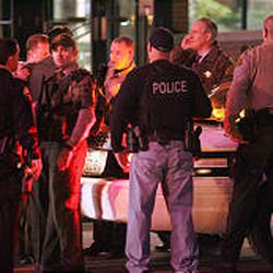 Police from several area agencies converge at Trolley Square Mall in Salt Lake City Monday night following a shooting that left several injured and a gunman dead.
