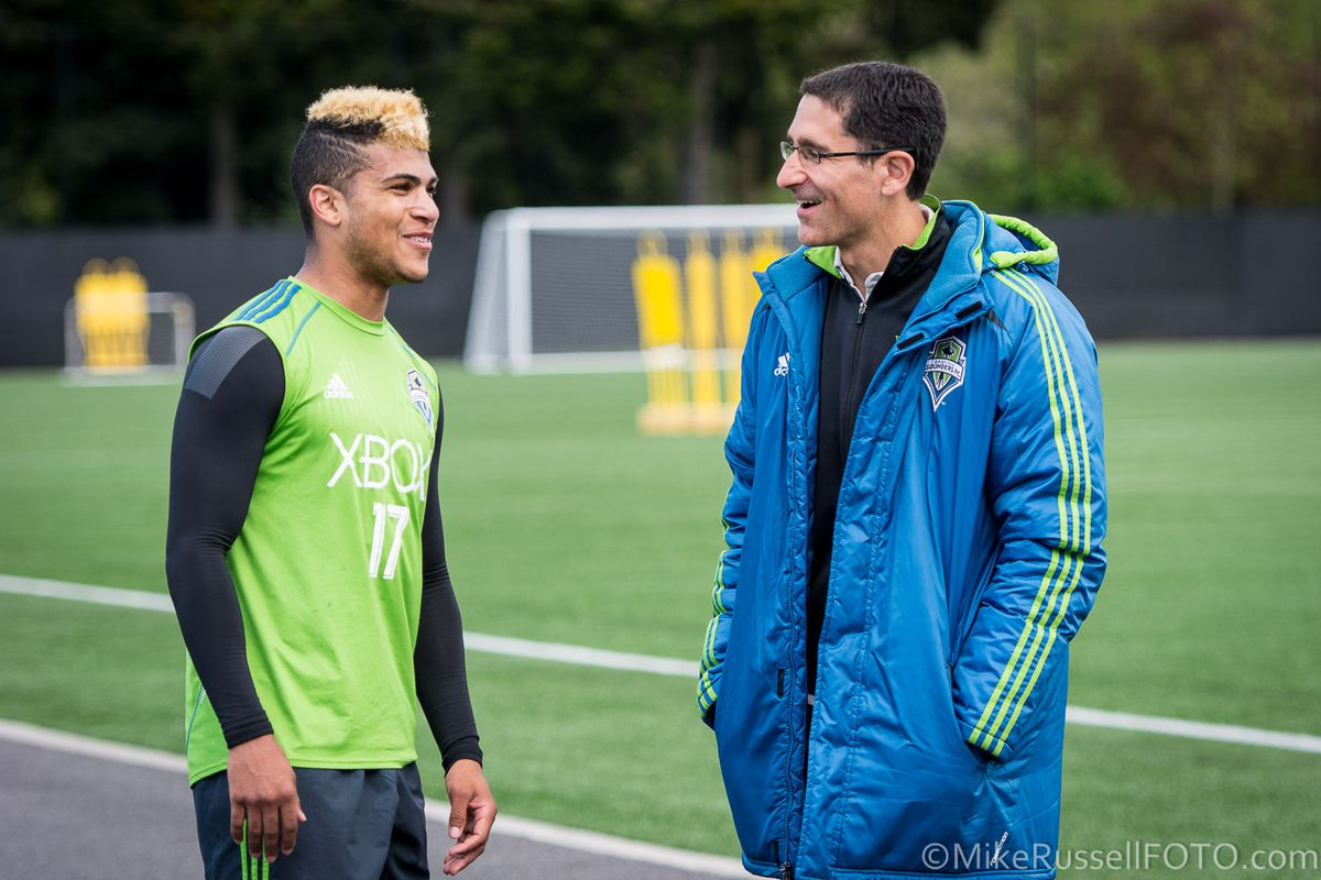 Yedlin and Hanauer talk at a practice several months ago
