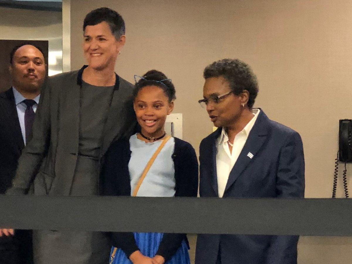 Lori Lightfoot (right) with her wife, Amy Eshleman, and their 10-year-old daughter, Vivian, at Thursday's news conference announcing her candidacy for mayor.