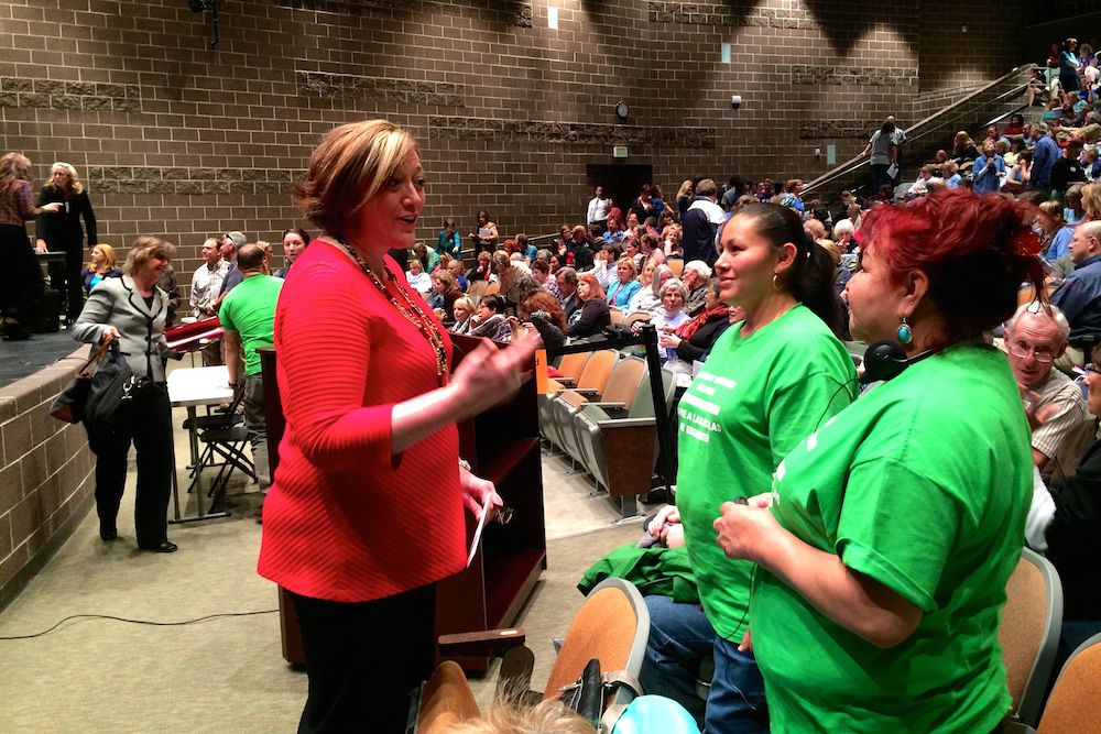 Jeffco board member Lesley Dahlkemper, left, speaks with parents during a break at the board's May 2 meeting at Bear Creek High School.