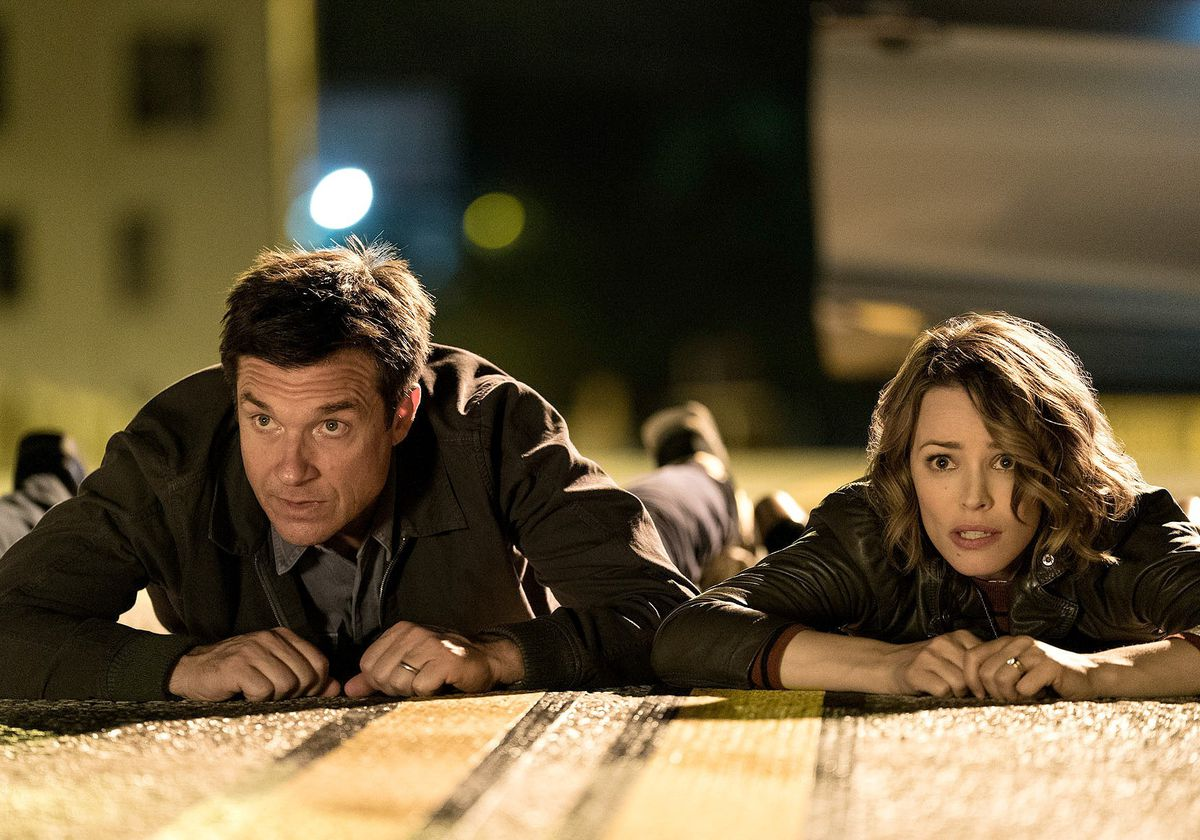 Jason Bateman and Rachel McAdams face down on the floor in 'Game Night'