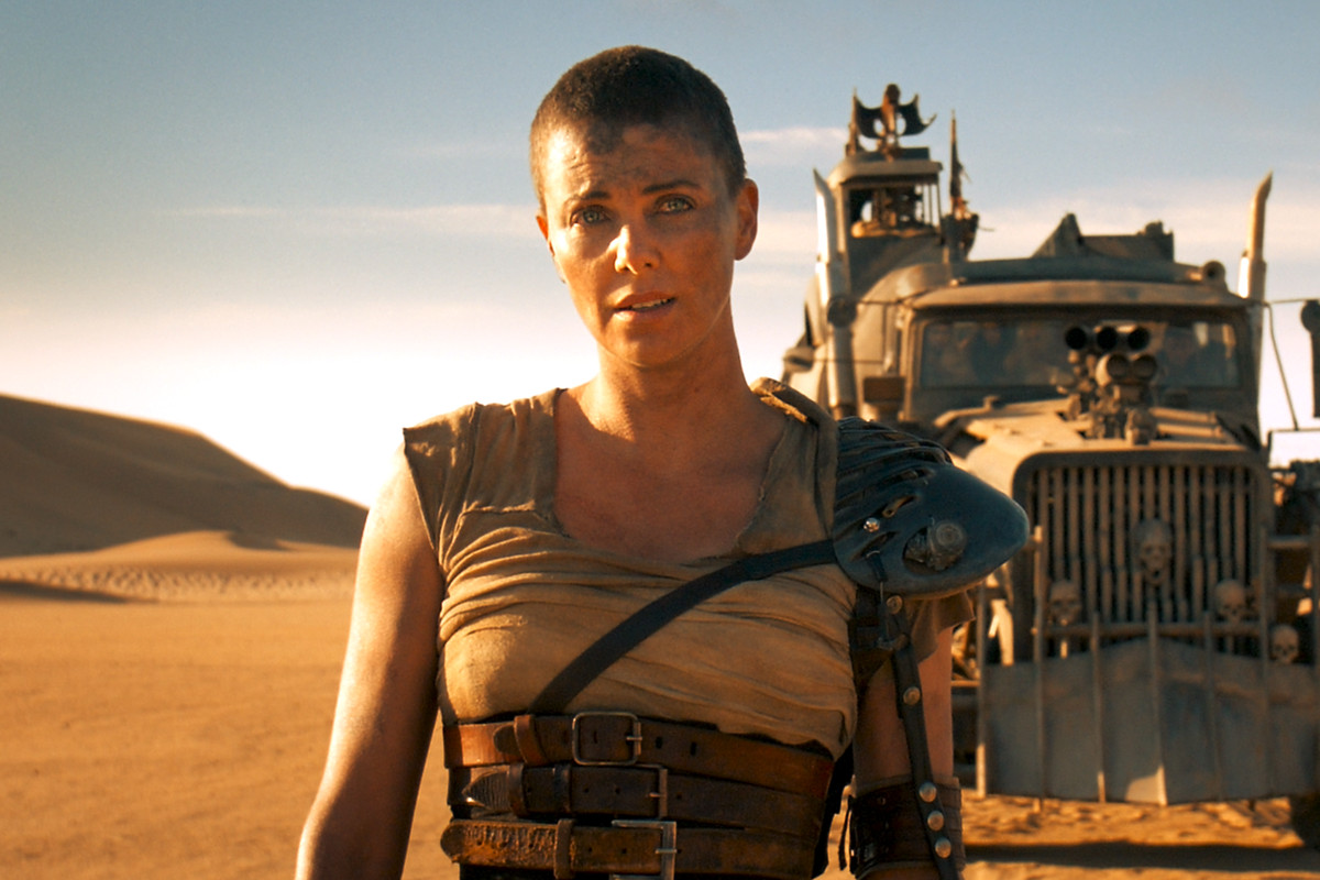 Furiosa standing in front of her truck in Mad Max: Fury Road