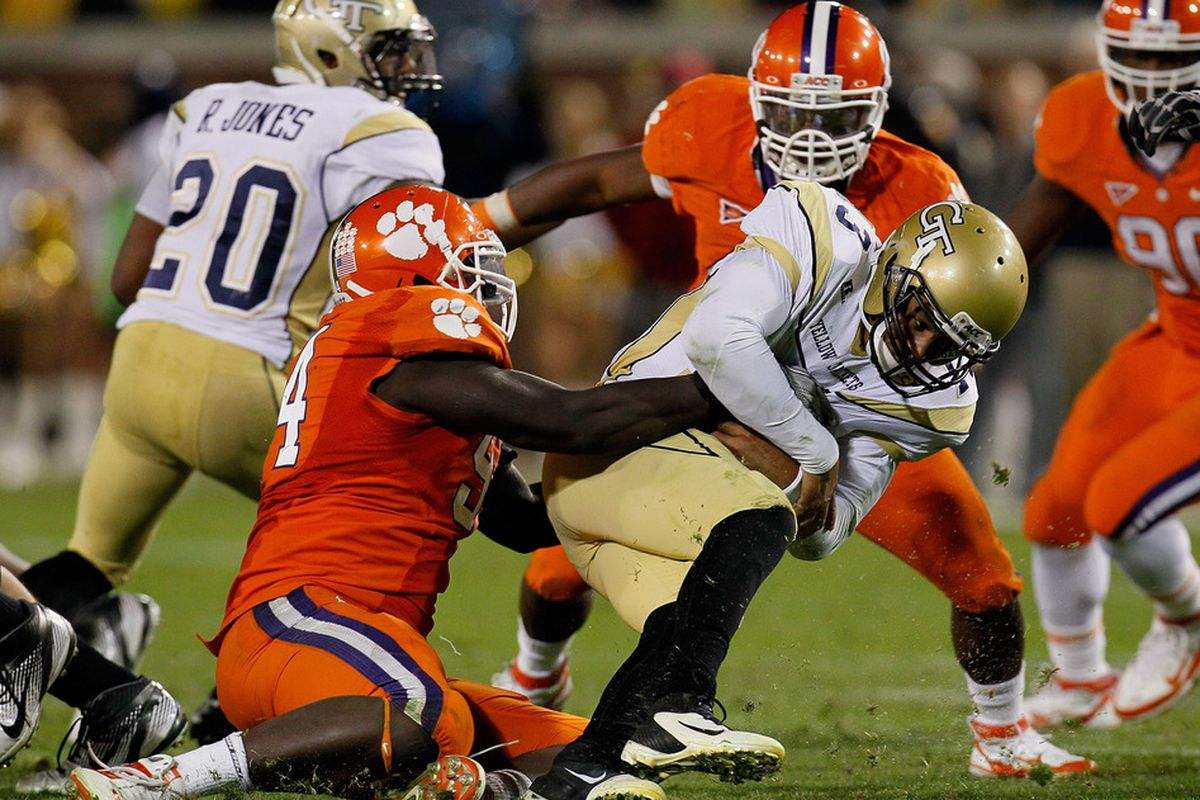 ATLANTA, GA - OCTOBER 29:  Rennie Moore #94 of the Clemson Tigers sacks Tevin Washington #13 of the Georgia Tech Yellow Jackets at Bobby Dodd Stadium on October 29, 2011 in Atlanta, Georgia.  (Photo by Kevin C. Cox/Getty Images)
