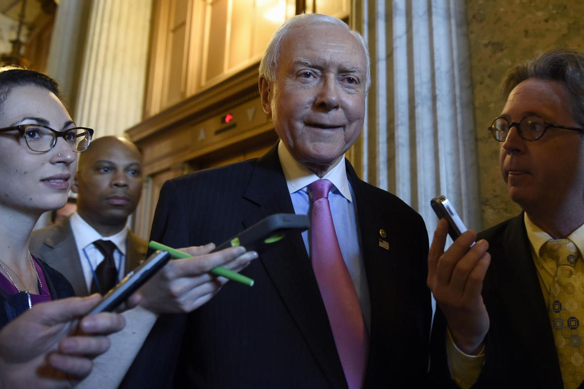 Sen. Orrin Hatch, R-Utah. is surrounded by reporters as he walks to a luncheon with other Senate Republicans on Capitol Hill in Washington, Friday, May 22, 2015.