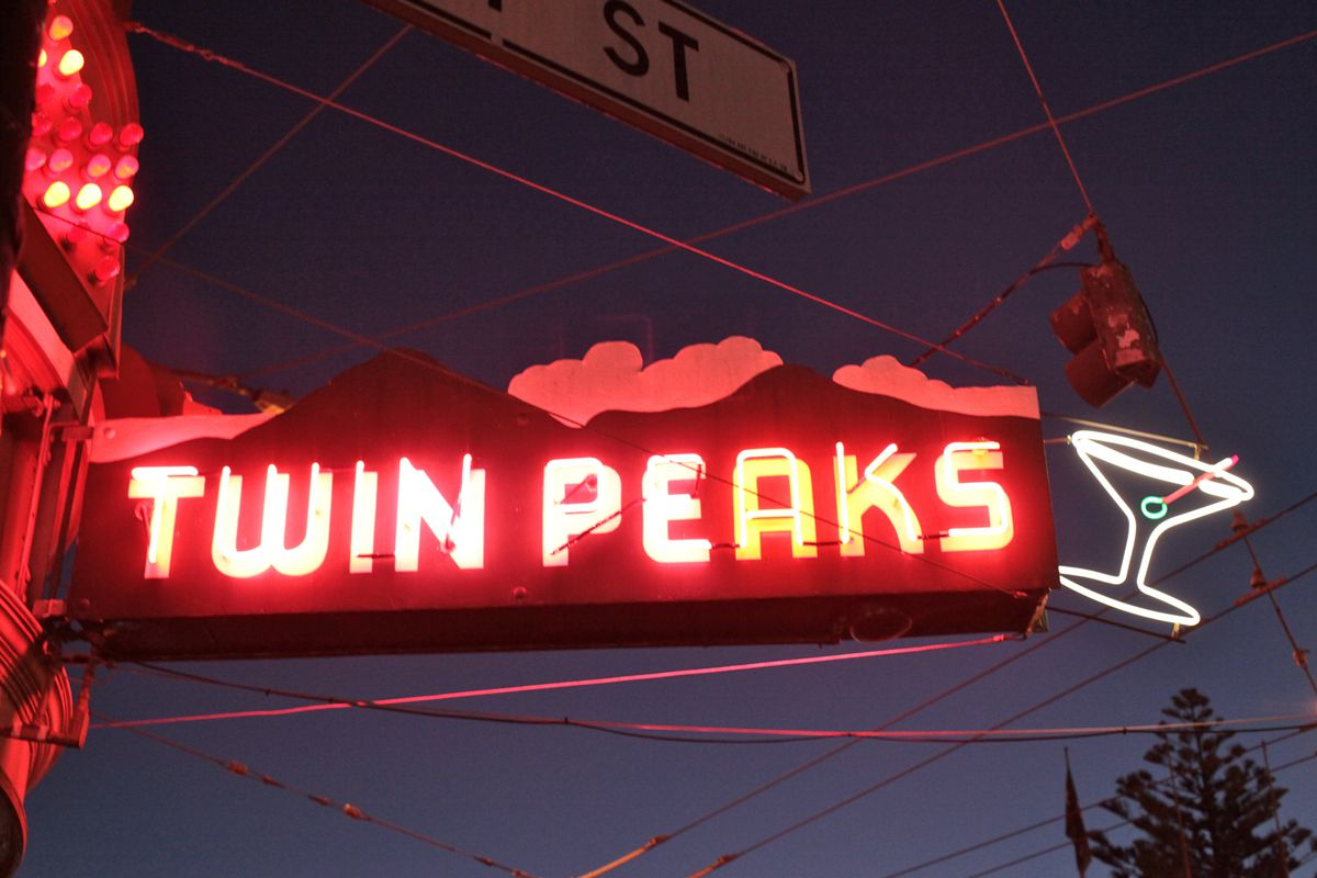 Twin Peaks Tavern's neon sign lit up at night