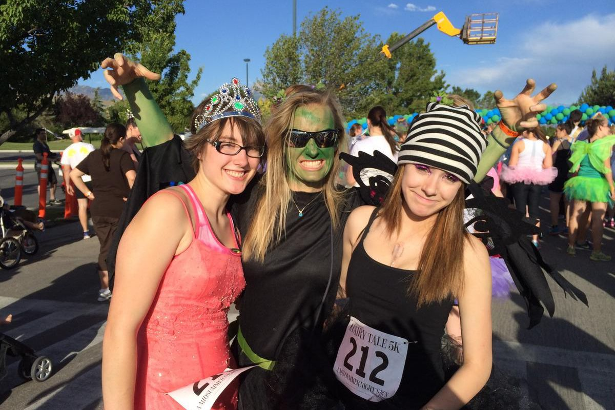 Deseret News reporter Amy Donaldson, aka The Wicked Witch of the West, center, and her daughter, Rachel Gitlin (left, dressed as a princess) and family friend, Annie Jackson (right, dressed as a naughty fairy) get ready for the Fairy Tale 5K at Thanksgivi