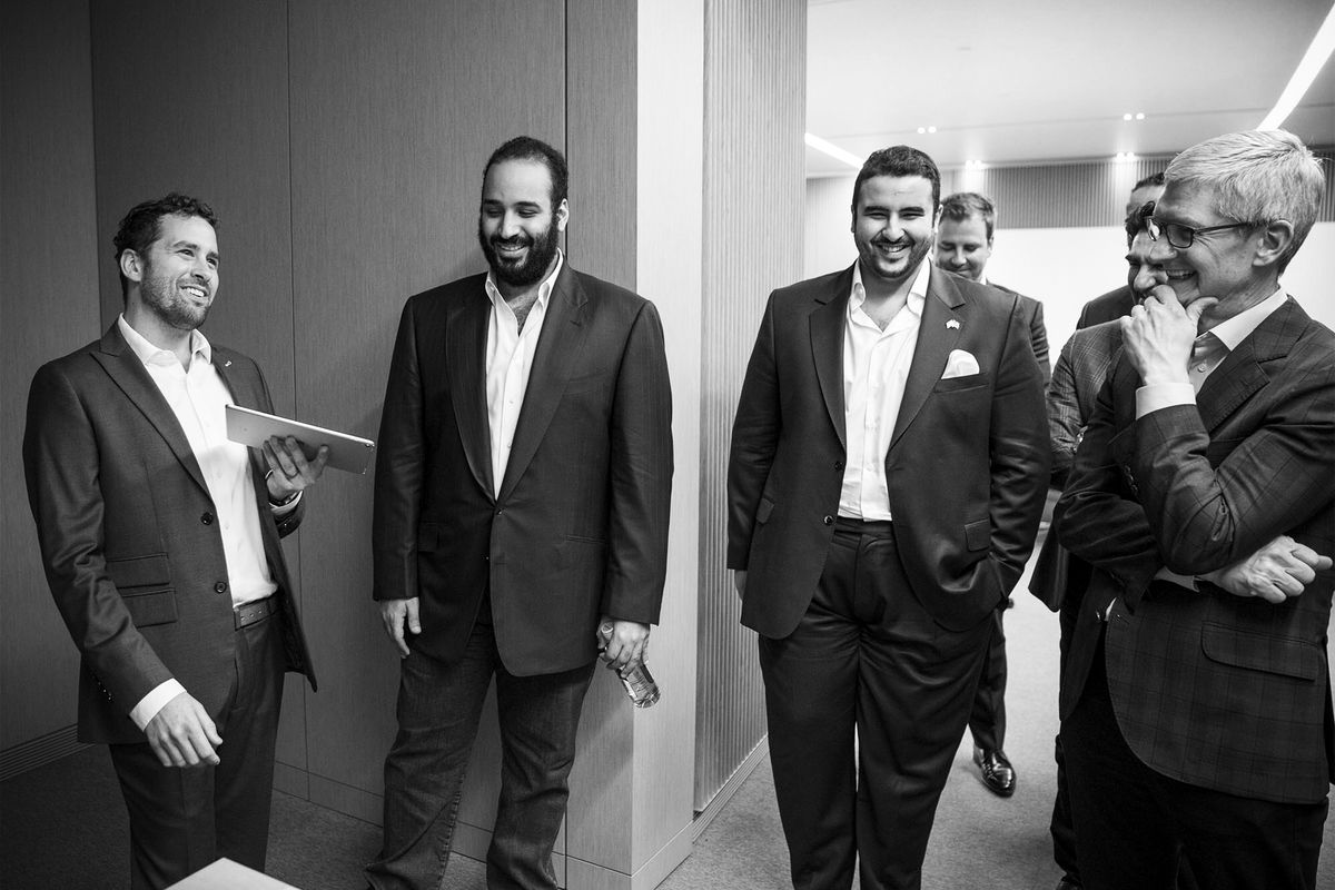 In this handout photograph from the Saudi Kingdom Council, Crown Prince of Saudi Arabia Mohammed bin Salman (second from left) is being led through Apple offices in Cupertino, California, with Apple CEO Tim Cook (right), on April 6, 2018.
