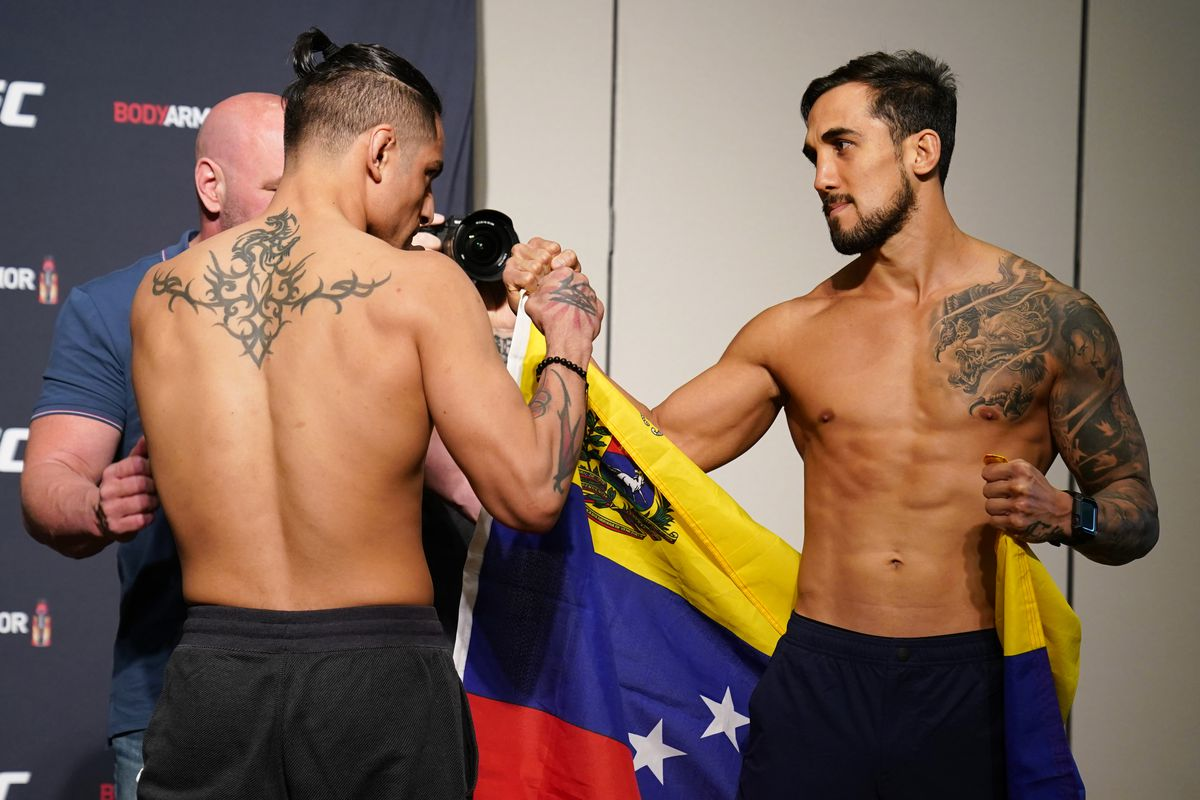 Opponents Gabriel Benitez of Mexico and Omar Morales of Venezuela face off during the official UFC Fight Night weigh-in on May 12, 2020 in Jacksonville, Florida.
