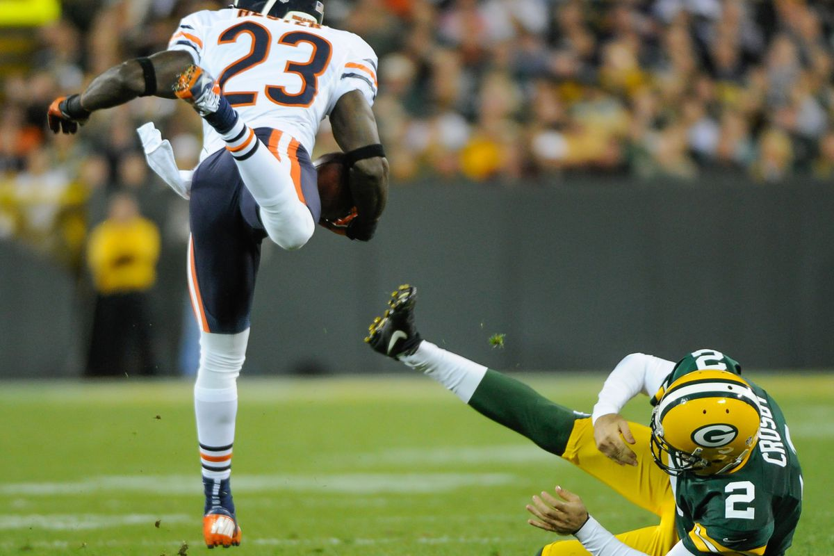 Sept 13, 2012; Green Bay, WI, USA;   Chicago Bears wide receiver Devin Hester (23) is tripped up by Green Bay Packers kicker Mason Crosby (2) on a kickoff return at Lambeau Field.  Mandatory Credit: Benny Sieu-US PRESSWIRE