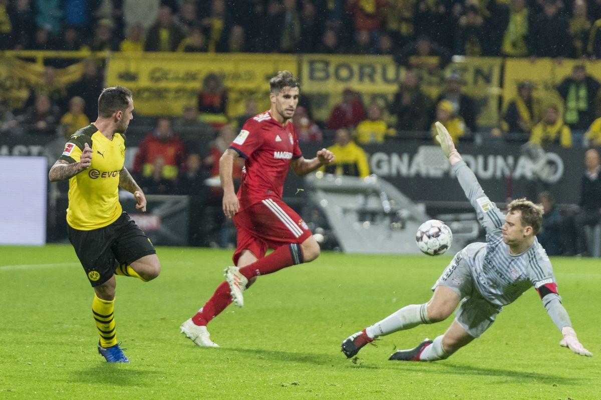DORTMUND, GERMANY - NOVEMBER 10: Paco Alcacer of Borussia Dortmund scores the winning goal to the 3:2 during the Bundesliga match between Borussia Dortmund and FC Bayern Muenchen at the Signal Iduna Park on November 10, 2018 in Dortmund, Germany.