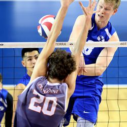 BYU's Miki Jauhiainen hammers down a spike on Pepperdine's Austin Wilmot as they play in the finals of the Mountain Pacific Sports Federation Championship, at the Smith Field House in Provo on Saturday, April 24, 2021. BYU won in straight sets.