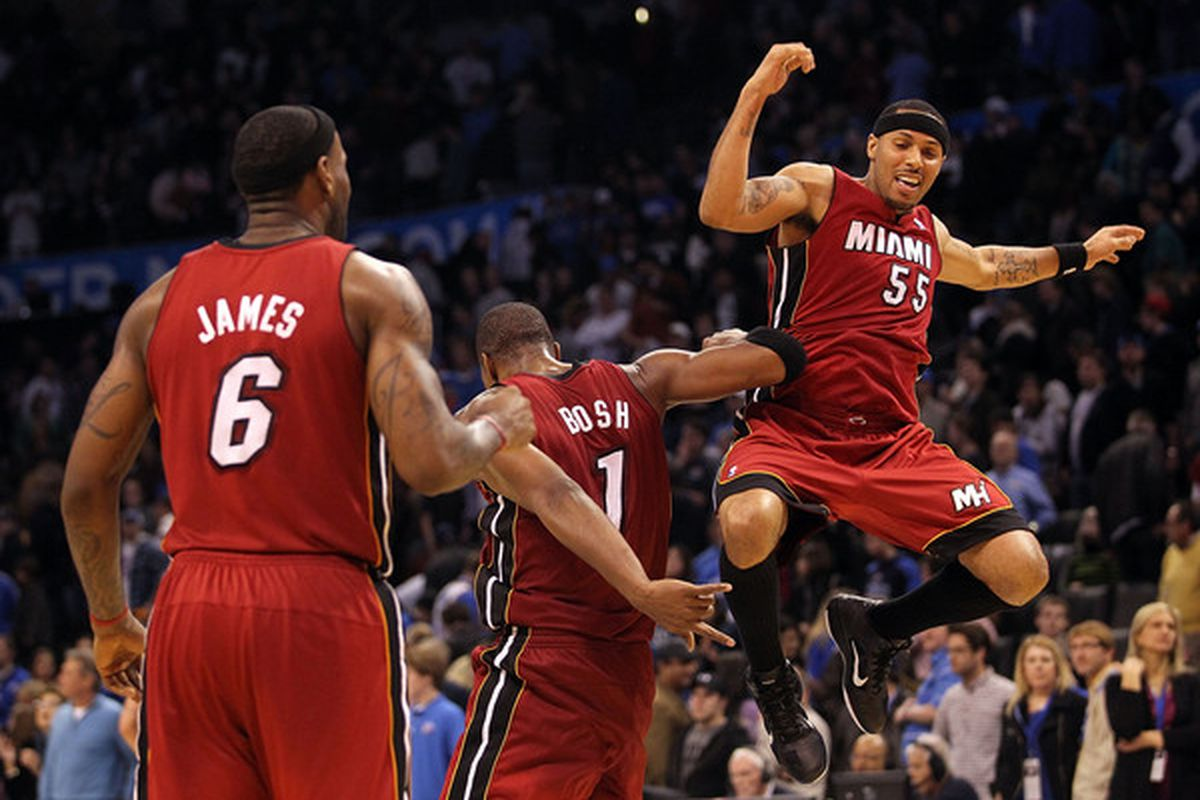 LeBron James, Chris Bosh, and Eddie House celebrate the Heat win over the Thunder.