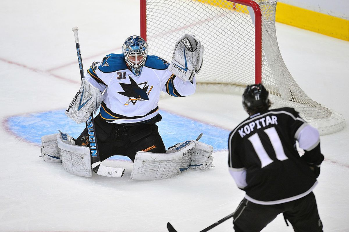 March 20, 2012; Los Angeles, CA, USA; Los Angeles Kings center Anze Kopitar (11) takes a shot against San Jose Sharks goalie Antti Niemi (31) during the second period at Staples Center. Mandatory Credit: Gary A. Vasquez-US PRESSWIRE