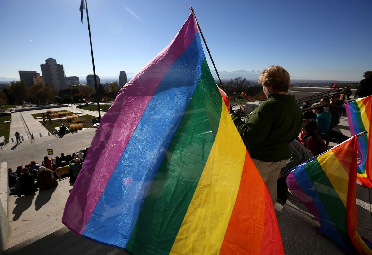FILE - Utah Faith Fair and Rally for Love, Equality, Family, and Acceptance outside of the state Capitol in Salt Lake City on Saturday, Nov. 21, 2015.