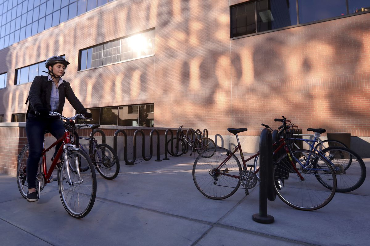 Erica Evans, Deseret News reporter, finishes her bike commute from South Salt Lake to the Deseret News in Salt Lake City on Wednesday, Nov. 7, 2018.
