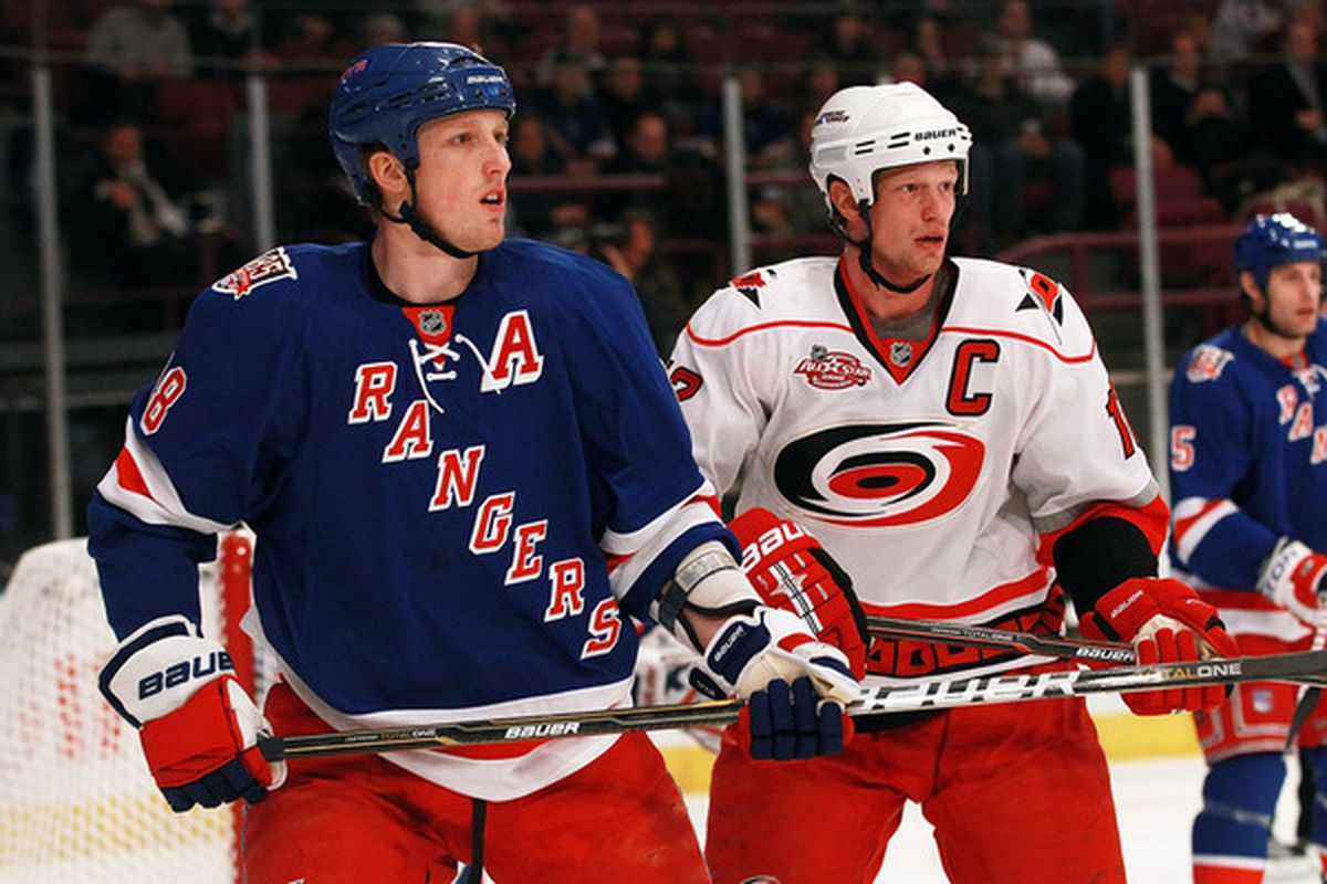 NEW YORK NY - JANUARY 05: Marc Staal #18 of the New York Rangers skates against his brother Eric Staal #12 of the Carolina Hurricanes at Madison Square Garden on January 5 2011 in New York City.  (Photo by Bruce Bennett/Getty Images)