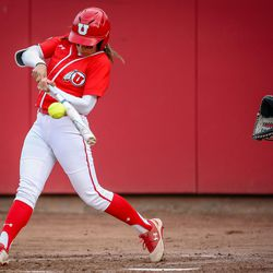 Utah outfielder Alyssa Barrera (16) slaps a ball to the infield in the first inning as the University of Utah hosts Brigham Young University at Duke Stadium in Salt Lake City on Wednesday, April 18, 2018.