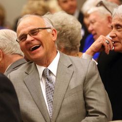 A man reacts to a story during a memorial service for Janie Thompson, the founder of BYU's internationally touring Young Ambassadors, at the BYU multi-stake center in Provo on Saturday, June 8, 2013.