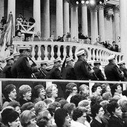 The Mormon Tabernacle Choir sings at the first inauguration of Richard Nixon on January 20, 1969, in Washington D.C., with Nixon and outgoing President Lyndon B. Johnson on the stand.