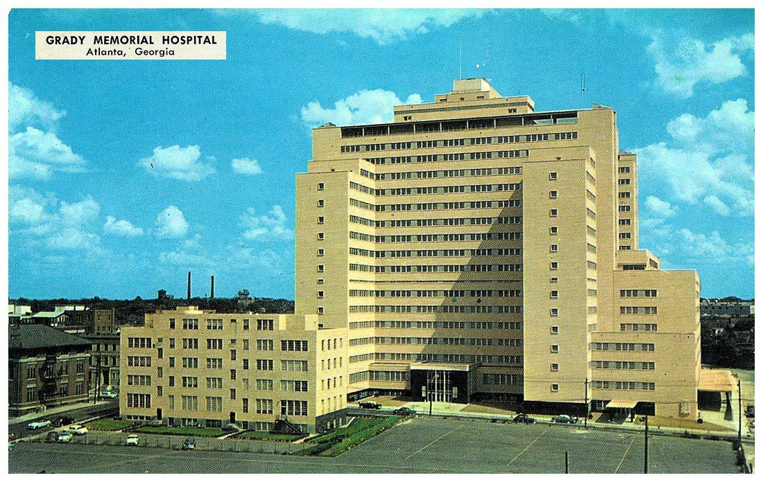 Postcard of the tan tower, before the interstate was built in front of it.