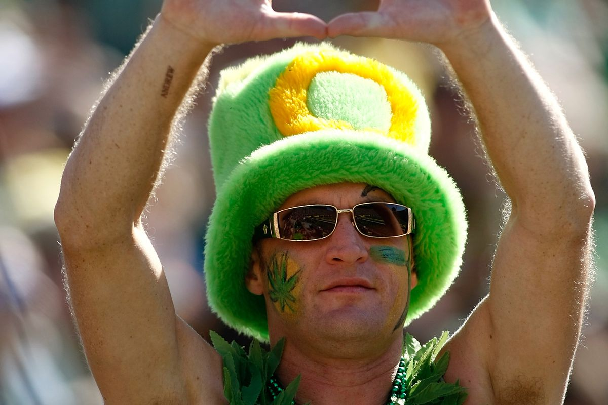EUGENE, OR - SEPTEMBER 15:  A fan of the Oregon Ducks cheers against the Tennessee Tech Golden Eagles on September 15, 2012 at the Autzen Stadium in Eugene, Oregon.  (Photo by Jonathan Ferrey/Getty Images)