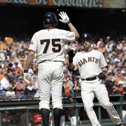 San Francisco Giants' Marco Scutaro, right, is met at the plate by Barry Zito (75) after Scutaro's two-run home run against the Arizona Diamondbacks during the second inning of a baseball game Thursday, Sept. 27, 2012, in San Francisco.