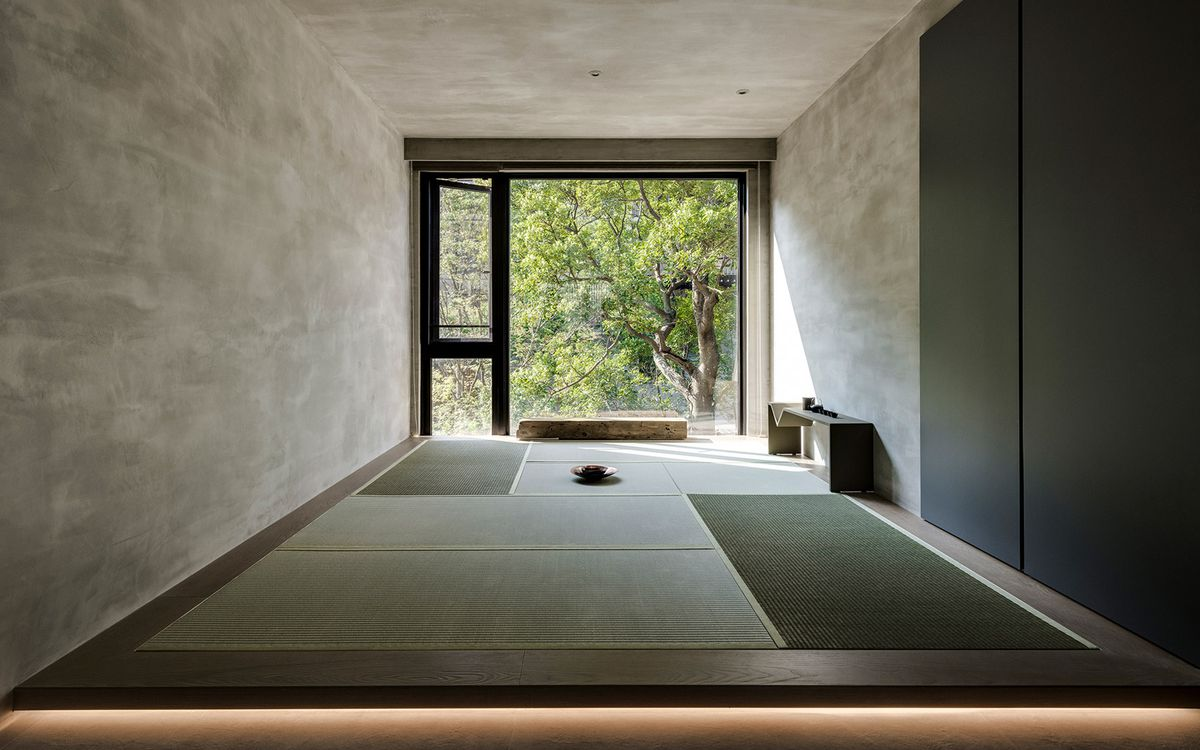 Meditation room with mats on floor and large window