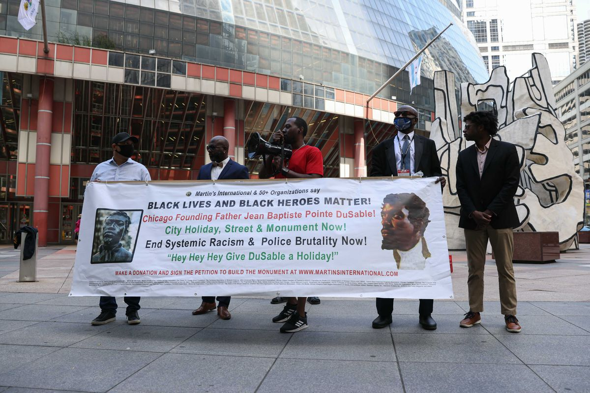 Supporters of the renaming of the outer portion of Lake Shore Drive gathered outside the Thompson Center, across the street from City Hall, in the Loop on Wednesday, May 26, 2021.