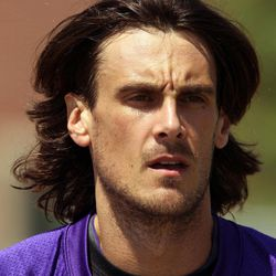 In this July 28, 2012 photo, Minnesota Vikings punter Chris Kluwe is shown at NFL football training camp in Mankato, Minn. NFL punters are only seen on fourth down, and heard from less than that. But with a constitutional gay marriage ban on Minnesota's ballot this fall, Kluwe has emerged as a high-profile gay rights champion _ and a symbol of changing attitudes toward homosexuality in the sports world.