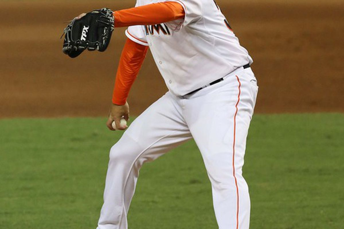 May 15, 2012; Miami, FL, USA; Miami Marlins relief pitcher Edward Mujica (34) throws against the Pittsburgh Pirates in the eighth inning at Marlins Park. Mandatory Credit: Robert Mayer-US PRESSWIRE