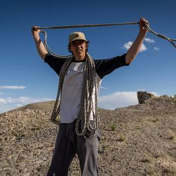 Hawkwatch International field biologist Max Carlin coils a rope after the team entered a golden eagle nest to take samples and data from a nestling in a remote area of Box Elder County on Wednesday, May 19, 2021.