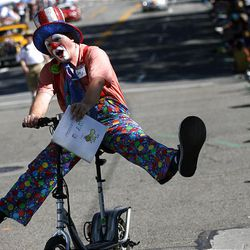 A clown rides through downtown Salt Lake City in the Days of '47 Parade on Saturday.