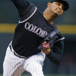 Colorado Rockies starting pitcher Jhoulys Chacin works against the Arizona Diamondbacks in the first inning of a baseball game in Denver, Saturday, April 14, 2012.