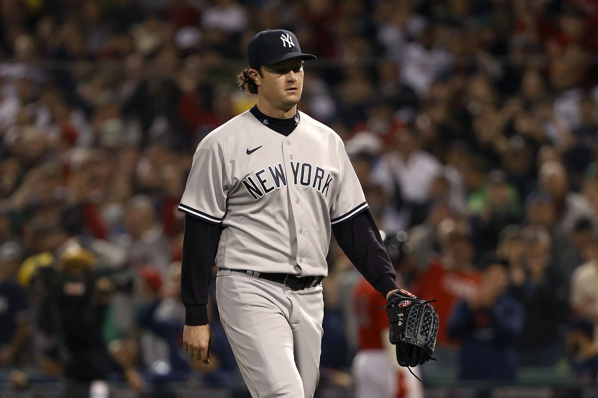 Gerrit Cole #45 of the New York Yankees walks to the dugout after being taken out against the Boston Red Sox during the third inning of the American League Wild Card game at Fenway Park on October 05, 2021 in Boston, Massachusetts.