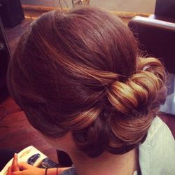 """Julianne Bryce, another senior stylist at George the salon, is loving the """"textured bun"""" this wedding season. [Photo: Courtesy of Julianne Bryce.]"""