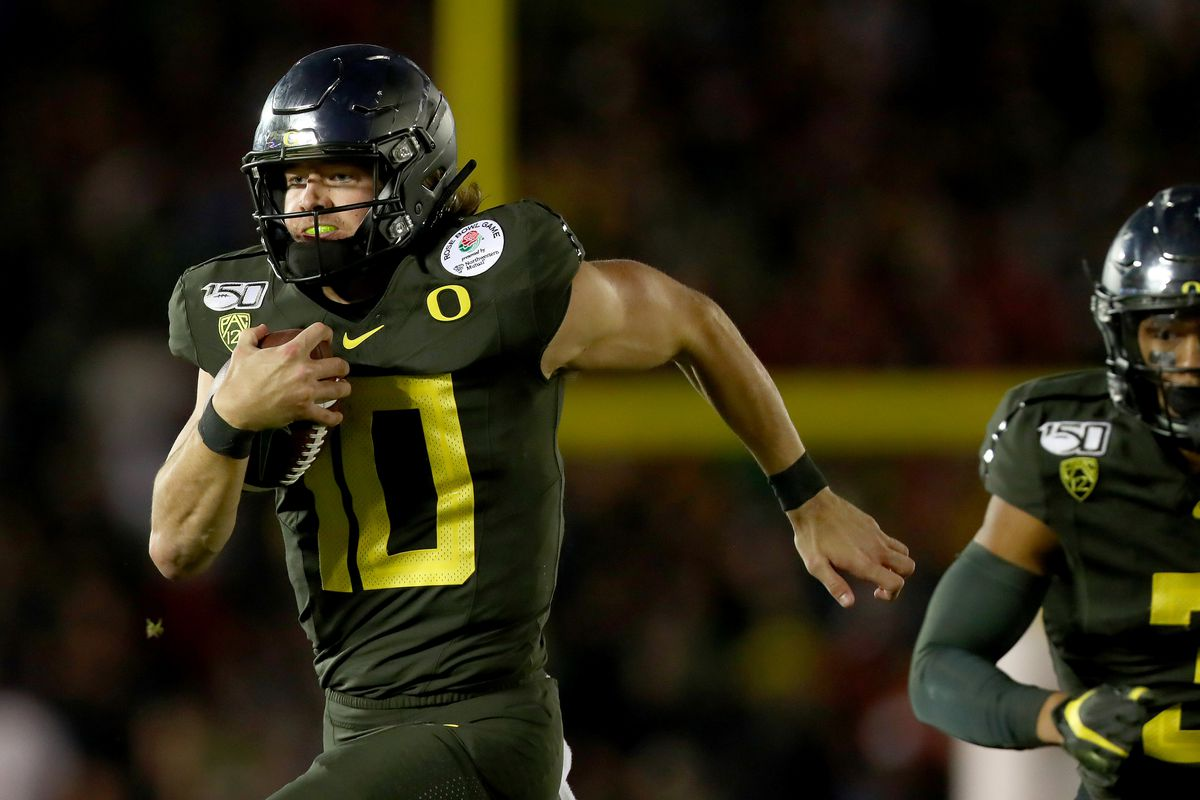 Justin Herbert of the Oregon Ducks runs with the ball to score a 30 yard touchdown against the Wisconsin Badgers during the fourth quarter in the Rose Bowl game presented by Northwestern Mutual at Rose Bowl on January 01, 2020 in Pasadena, California.