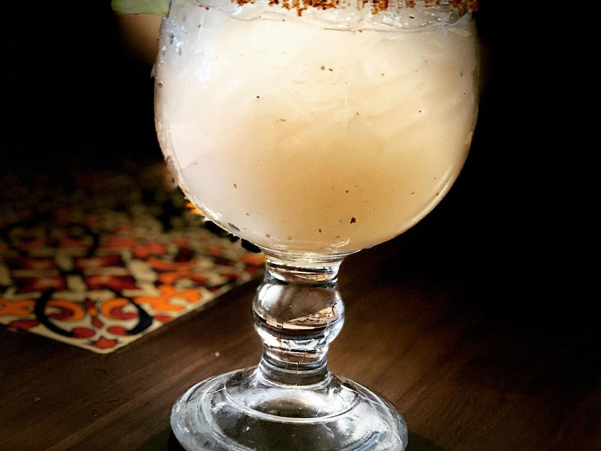An icy margarita in a glass